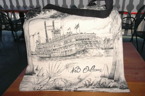 Charcoal black & white tote bag with the NATCHEZ among cypress trees and hanging moss